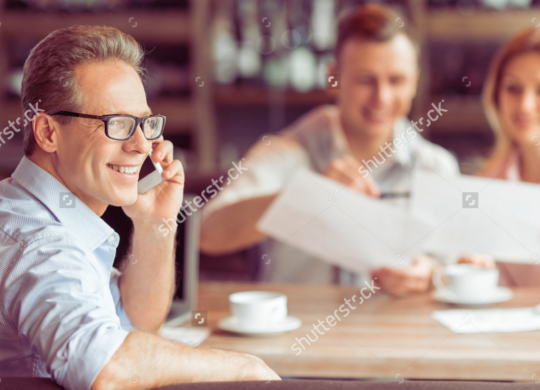 2016-11-29-15_17_37-handsome-middle-aged-businessman-in-eyeglasses-is-talking-on-the-mobile-phone-i
